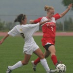 Alison Rethwisch and a St. Ben's player battle for the ball