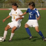 Chris Pinahs shields a Luther player away from the ball