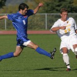 Grant Morlock clears the ball out of the Gustavus zone past an outstretched Macalester attacker.