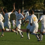 Jeff Aasness leads a Gustie goal celebration