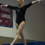 Laura Hansen performs on the balance beam.