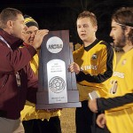 Men's soccer team accepting second place NCAA trophy last November.