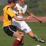 Jenna Iaizzo battles a Cobber for control of the ball.