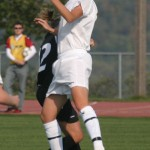 Liz Petersen heads the ball for Gustavus.