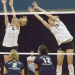 Jessica Plemel (left) and Meghan Gehring (right) attempt to block a Bethel shot.