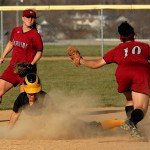 Emily Klein steals a base in the Gusties 6-0 win in game two.