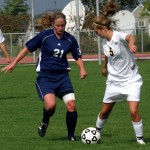 Becca Hagen works  to keep the ball from a Carleton player.