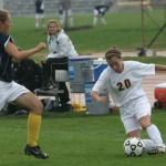 Chelsea Craven hustles to get the loose ball for Gustavus.