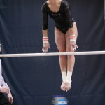 Kelly Mathewson performs on the uneven parallel bars.