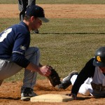 Nate Ruff slides safely back into first base.