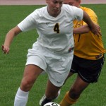 Callie Christensen fights to get past a Cobber defender.
