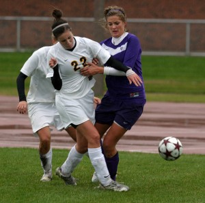 Gustavus midfielder Meghan Zenner battles for position with St. Thomas midfielder Alison True