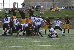 Christian Vanek blocks Carleton's 38 yard field goal attempt