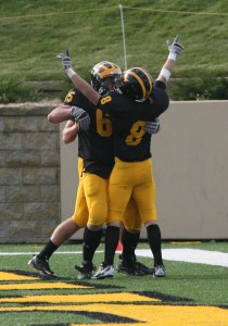 Elliot Herdina celebrates after scoring the game winning touchdown