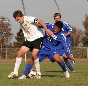 Bret VanderStreek battles a Luther player for possession.