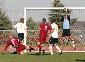 Luke Strom leaps to make a save against the Pipers.