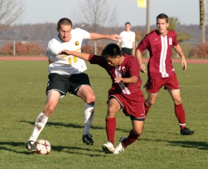 Fraser Horton makes a move to get past a Hamline defender in the midfield.