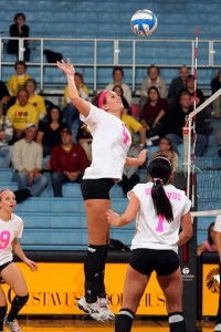 Middle hitter Angela Ahrendt goes up for a kill.