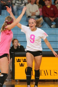 Janey Helland (#9) celebrates with Erin Sherman (pink jersey).