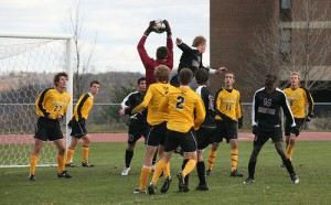 Gustavus goalkeeper Luke Strom goes high to save an Augsburg corner kick.