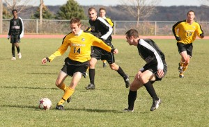 Mark Adams, shown here passing to a teammate, scored the gamewinner for the Gusties.