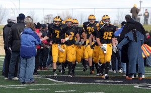 The players run through a tunnel made by the football parents at the beginning of the second half.