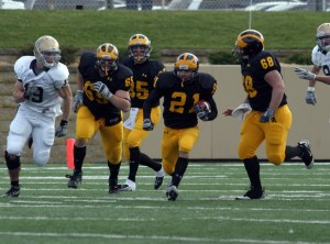 Running back Greg Ramaker breaks into the open for the Gusties.