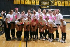 The Gusties show off their pink uniforms before the Bethany match.