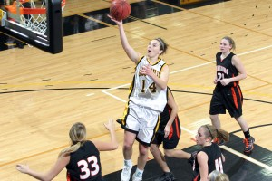 Julia Schultz drives up the middle of the lane for a layup.