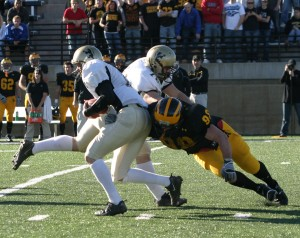 Christian Vanek registers one of his three quarterback sacks on the day.
