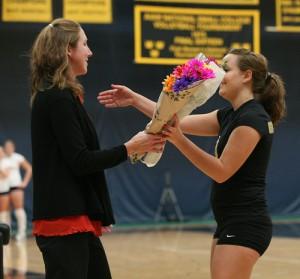 Tara Kramer is recognized on Senior Day by Head Coach Kari Eckheart