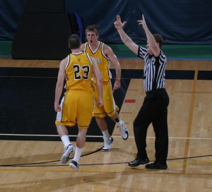 Phil Wirtjes celebrates with teammate Dan Schmidtknecht after hitting a 50ft buzzer beater to defeat Concordia in Overtime