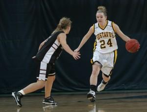 Liz Shay brings the ball up the floor.