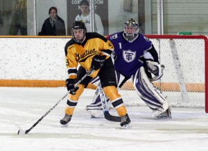 Eric Bigham camps out in front of St. Thomas goaltender