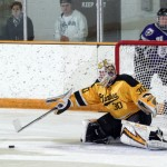 Josh Swartout makes one of his 20 saves in the game.