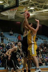 Senior Sam Paulson goes up hard to the basket.  Paulson finished with a game-high 15 points and eight rebounds.