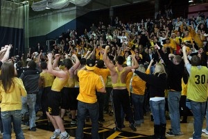 The Gustavus student body celebrates the victory by rushing the court after the game