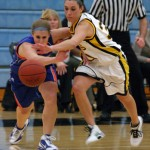 Ava Perry battles a Macalester player for possession of a loose ball.