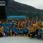 Gustavus women's hockey team with Ascona Select team after game outdoors in the Swiss Alps.