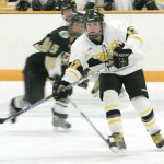 Lindsey Hjelm skates into the St. Olaf zone looking for the puck.