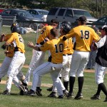 Tim Miller congratulated after his game-winning RBI single