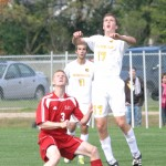 Ben Ceder goes up to head a ball out of the Gustavus defensive end.