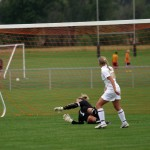 Senior attacker Ashley Anderson beats Central goalkeeper Steph Hasken for a goal in the first period