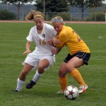 The Gusties' Karen Maus battles in the midfield with Karen Mayer of Concordia.