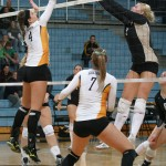 Angela Ahrendt battles at the net with Kim Smisek of St. Olaf.