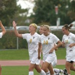 Teammates high-five Kristin Moen after her goal in the second half