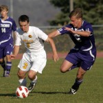 Doug Frey works past a Tommie defender.