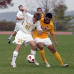 Brian Simons battles a Loras defender for possession.