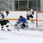 Sam Blaisdell happens upon the puck in the clear in front of the goal.