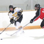 Adam Smyth battles Brady Horn of UW-River Falls for the puck.